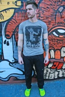 Cavan with tats, graffiti and Gracie shirt